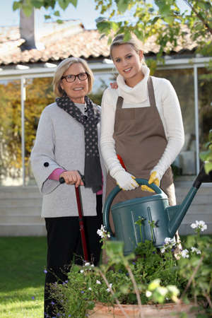 Grandmother and granddaughter gardening photo