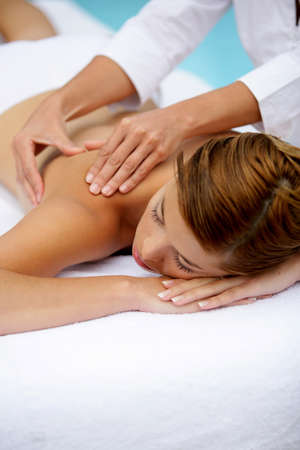 thalasso: Woman receiving a poolside back massage
