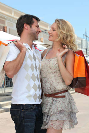couple with shopping bags photo