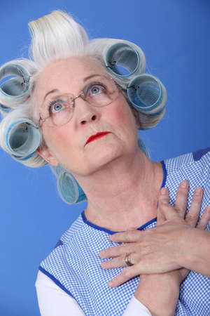 Elderly woman with her hair in rollers Stock Photo - 12219855