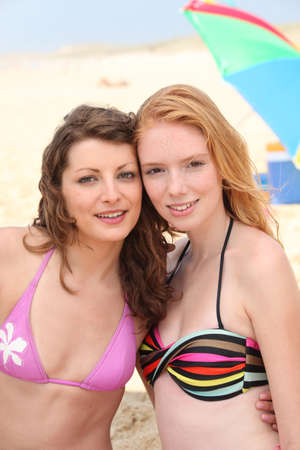 pale: Young women in bikinis on the beach