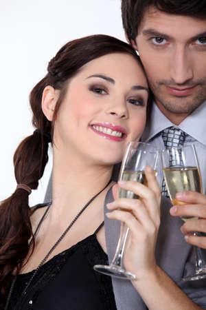 Couple having a celebratory drink Stock Photo - 12219543