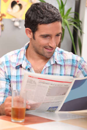 Man reading a magazine photo