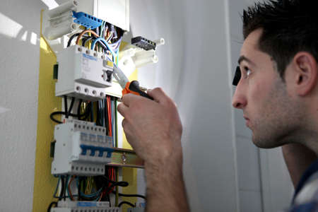 Man repairing fuse box photo