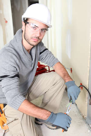 Electrician stripping a wire Stock Photo - 12250224
