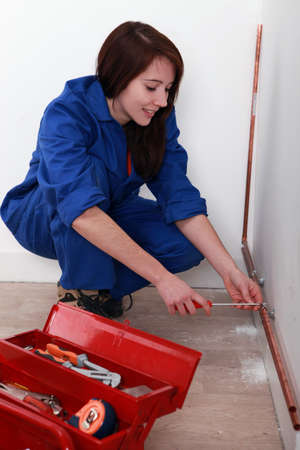 Female apprentice plumber photo