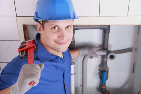 Handsome young plumber with a wrench Stock Photo - 12246901