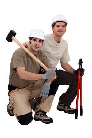 presslufthammer: Arbeiter mit Vorschlaghammer und Bolzenschneider