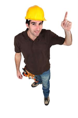 high angle shot: high angle shot of craftsman pointing upwards