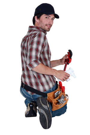 Attractive plumber with a wrench photo