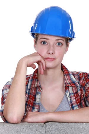 teary: Wide eyed female construction worker