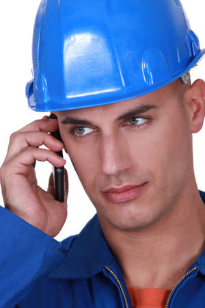 manly man: Tradesman talking on his mobile phone