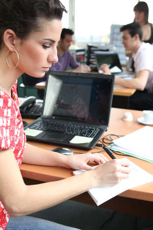 article writing: Woman preparing an essay Stock Photo