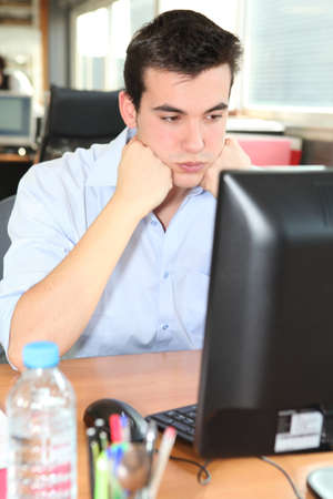 brood: Frustrated student in front of his computer Stock Photo