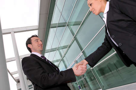 commitment: business people shaking hands Stock Photo
