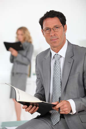 collaborator: smiling businessman with book Stock Photo