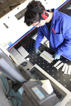 apprentice: Man operating cutting machine in workshop Stock Photo