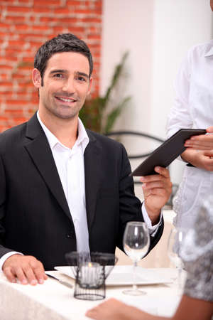 businessman eating in a restaurant Stock Photo - 12245296