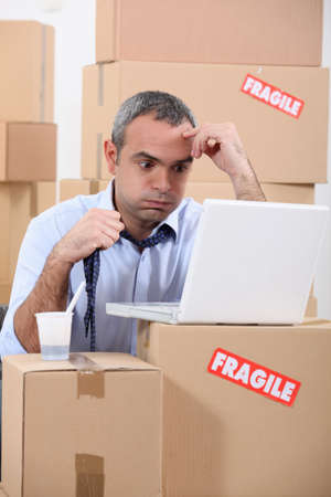 inventories: Stressed warehouse worker Stock Photo