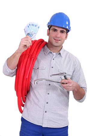 Plumber holding banknotes photo