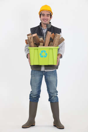 Environmentally friendly tradesman taking out the recycling photo