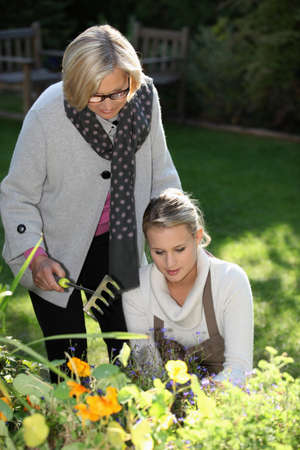 55 to 60: Mother and daughter gardening Stock Photo