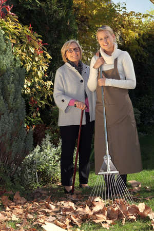Mother and daughter raking leaves photo