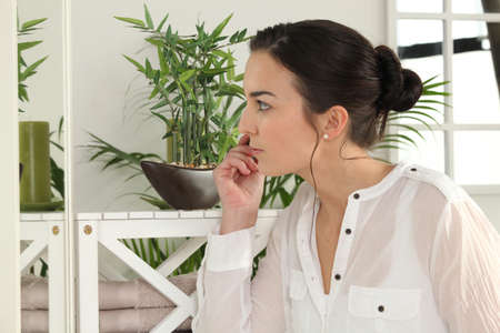 Woman looking at her plants Stock Photo - 12250321