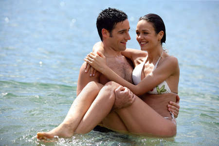 Couple stood in the sea photo