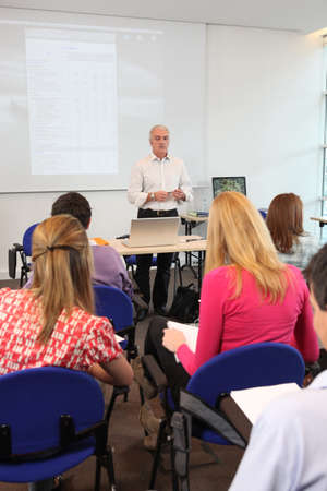 studygroup: Teacher stood at front of class room Stock Photo