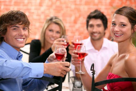 2 couples enjoying meal together photo