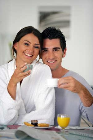 Smiling couple having breakfast photo