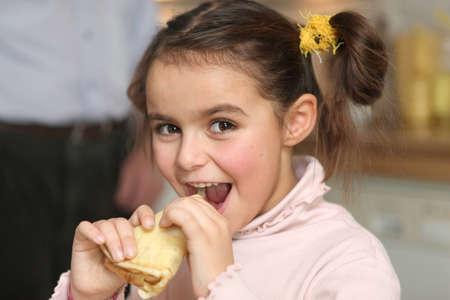 crepe: Happy girl eating a pancake