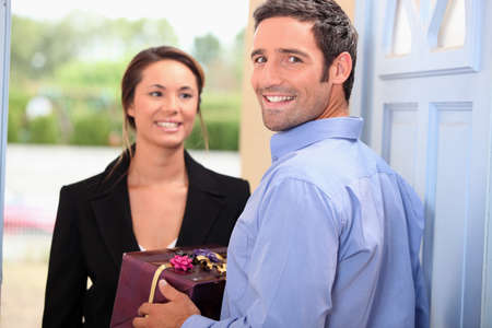 largesse: a man receiving a gift from his wife