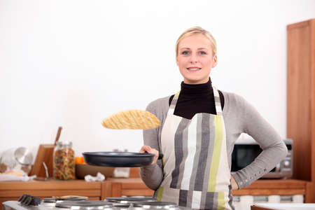Woman making pancakes photo
