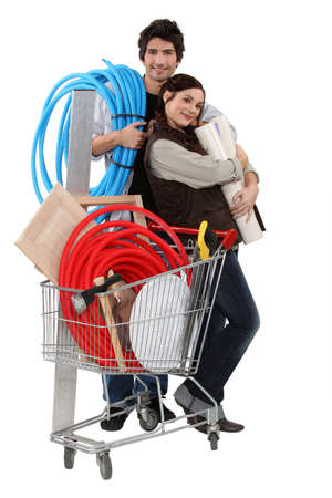 construction material: Couple with trolley full of supplies