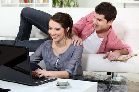 young couple relaxing at home Stock Photo - 12250314