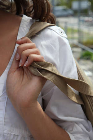 tote: Woman carrying a bag over her shoulder