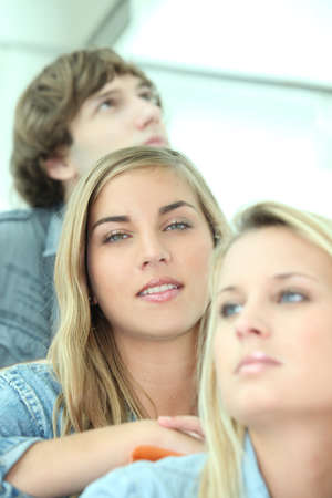 Three teenage friends sat down on stairs Stock Photo - 12249113