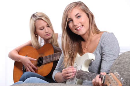 Girls playing the guitar photo