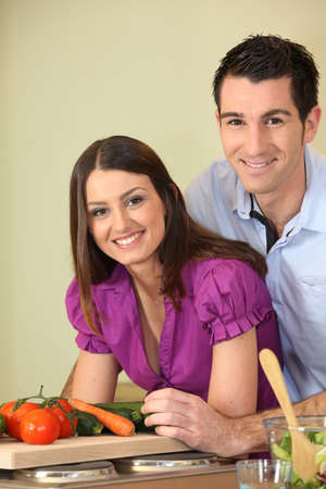 Young couple cooking in kitchen photo