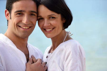 Closeup of couple at the beach photo