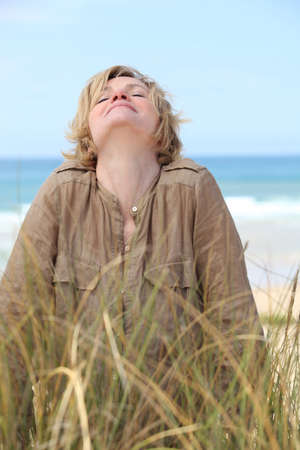 Woman stretching in the sand dunes photo