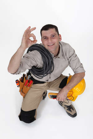 An electrician doing an ok sign. photo