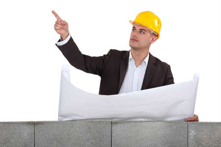 white headed: Engineer pointing to an area Stock Photo