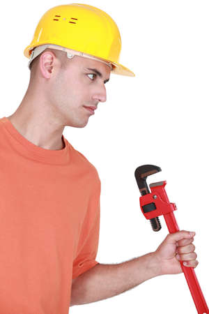 implement: craftsman holding a spanner