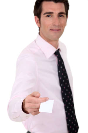 Man holding out his business card Stock Photo - 12245998