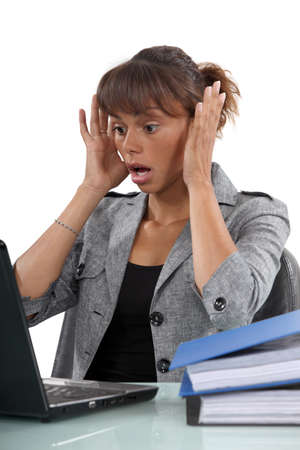 Distressed woman with laptop photo