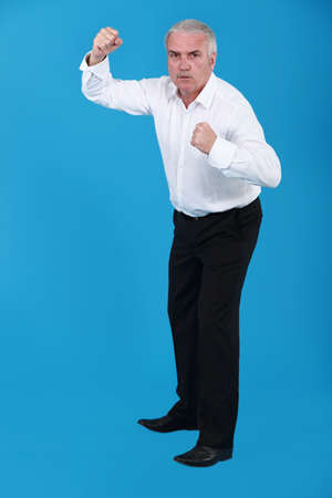 A businessman in a fighting stance. photo