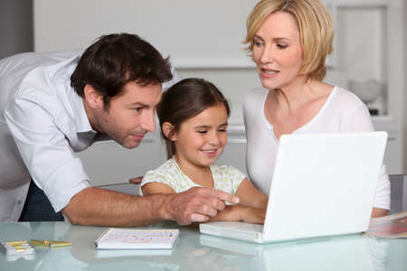 father teaching daughter: Family on laptop